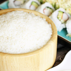 Bowl of sushi rice with California Roll and Sushi Roll