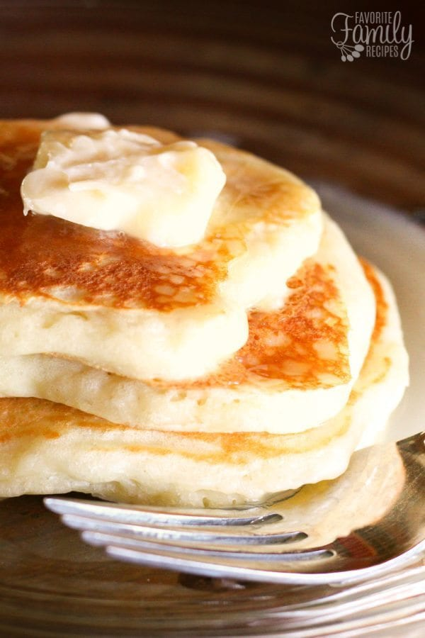 Yogurt Pancakes with Homemade Syrup stacked on a plate