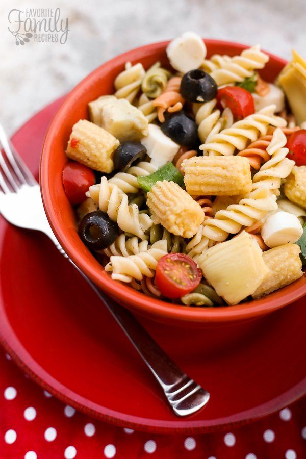 Italian Summer Pasta Salad served in a red bowl