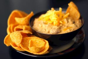 Chili and cream cheese combined in a dip for corn or tortilla chips