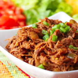 Crock Pot Mexican Shredded Beef served with chopped tomatoes, lettuce, and shredded cheese