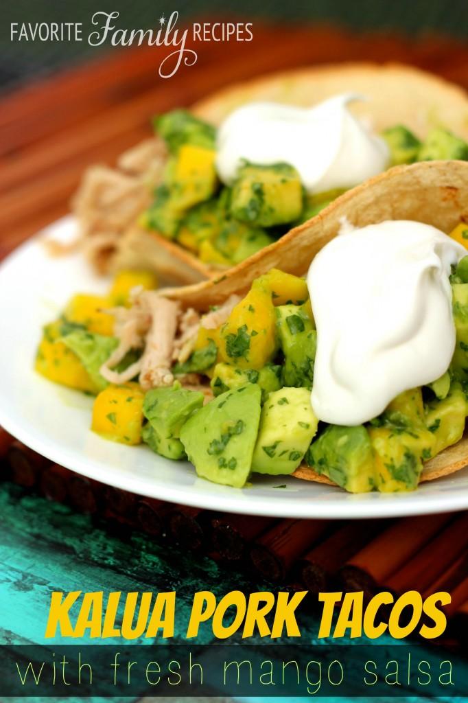 Close up of Kalua Pork Tacos With Mango Salsa on a white plate.