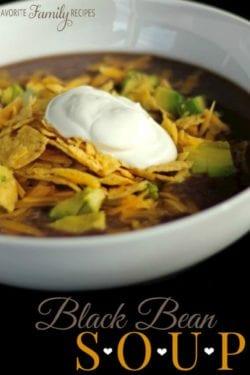 Black bean soup with tortilla strips, avocado, cheese, and sour cream