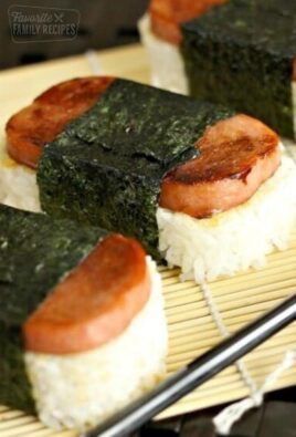 Spam Musubi, rice and spam wrapped in seaweed, on a bamboo sheet