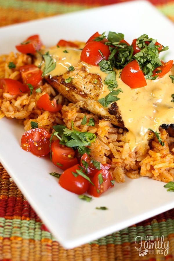 Cheesy Grilled Mexican Chicken and Rice served on a colorful placemat