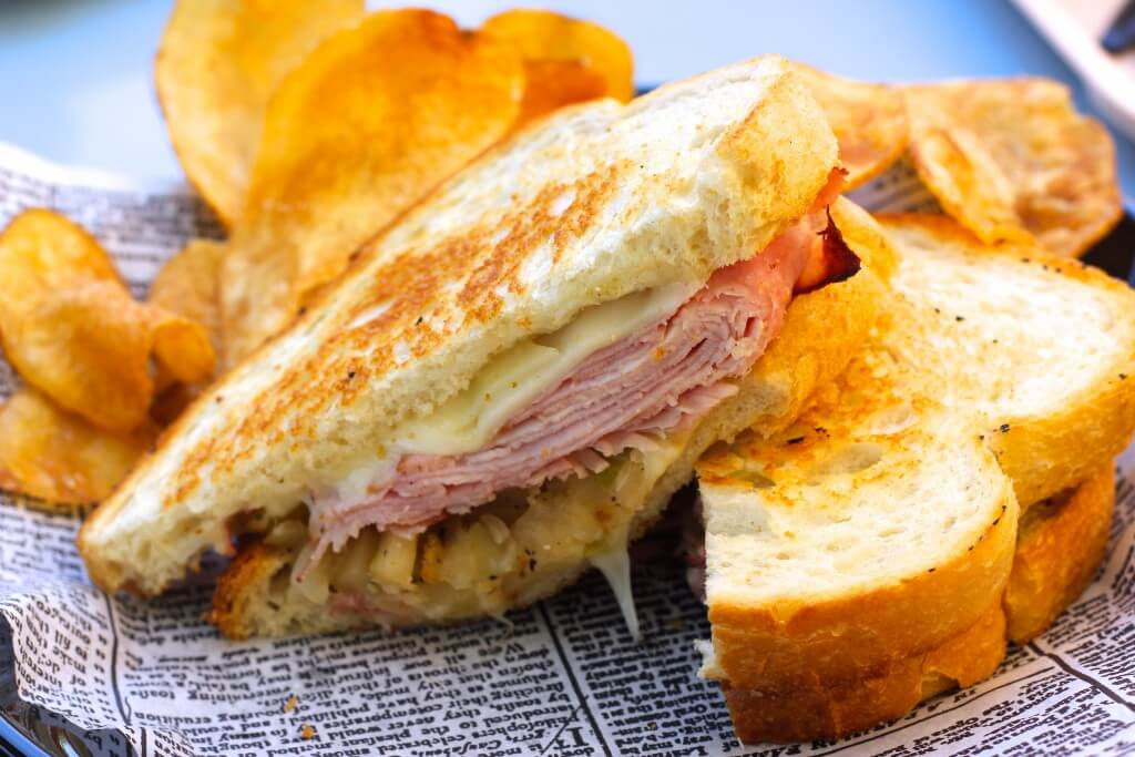 grilled ham sandwich with kettle chips