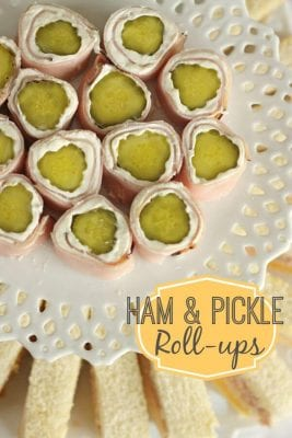 Dill pickles rolled in ham with a cream cheese spread