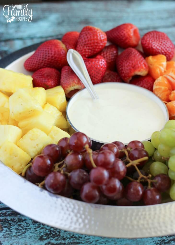 Cream Cheese Fruit Dip served with fresh pineapple, strawberries, oranges, and grapes