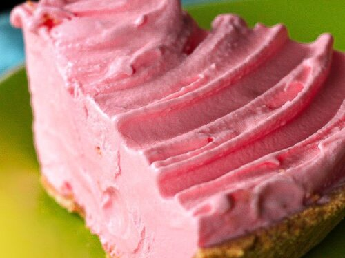 Slice of Pink Lemonade Ice Cream Pie on a plate