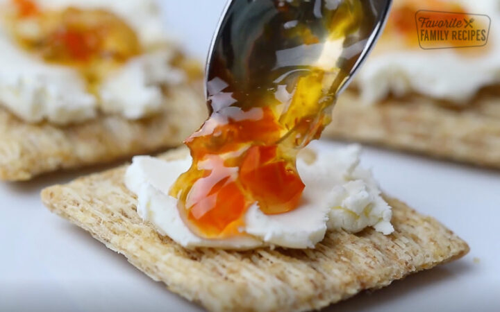 Serving pepper jelly on a cracker with cream cheese