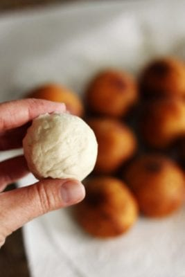 Close up of rolled up biscuit dough before it is fried.