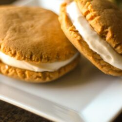 Pumpkin Sandwich Cookies with Maple Cream Cheese Frosting