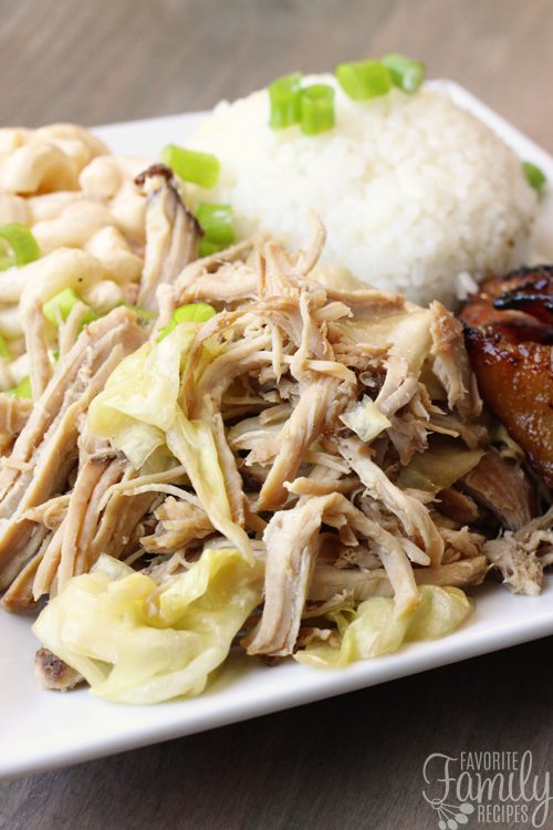 Kalua Pork with Cabbage is a Hawaiian dish often served at Luaus. This version is made in the slow cooker and tastes just like authentic shredded Kalua Pig.