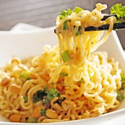 Thai Peanut Noodles in a peanut butter sauce with peanuts and seasonings