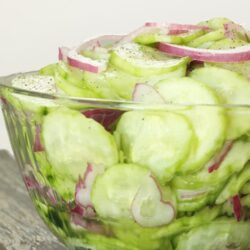 These Easy Vinegar Marinated Cucumbers are a light, refreshing, summertime side dish. Add regular or cherry tomatoes to make it a delicious cucumber salad!
