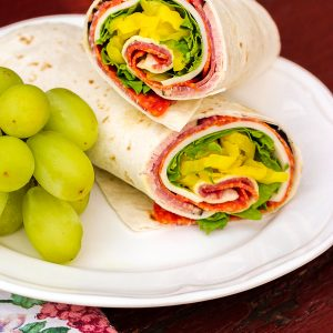 Italian meats and cheeses wrapped in a flour tortilla