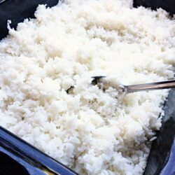 Cooking rice for a crowd is SO easy! Bake it in the oven and have up to 50 servings in less than an hour! Seasoning variations included.
