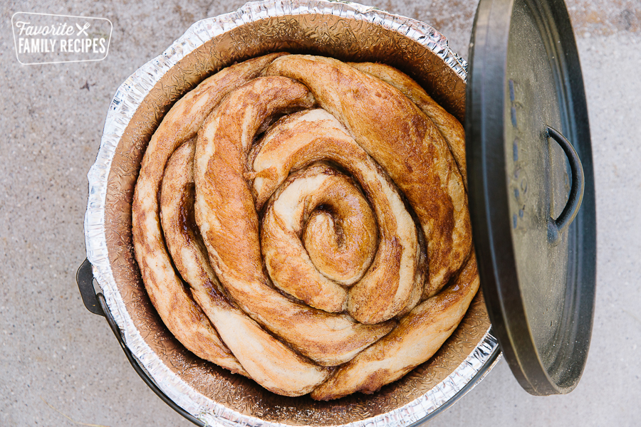 A Dutch Oven Cinnamon Roll baked in a Dutch Oven
