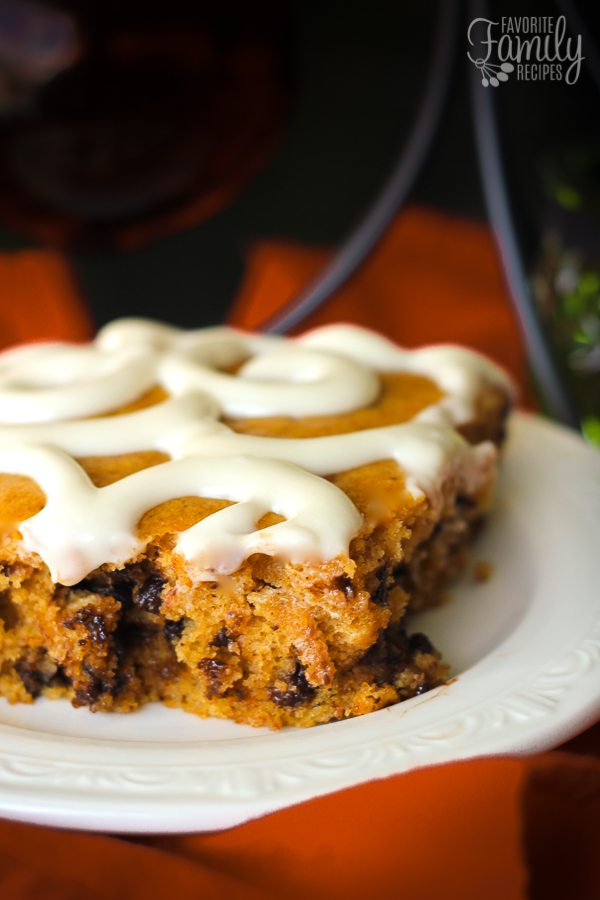 This Chocolate Chip Pumpkin Sheet Cake is the perfect recipe holiday parties! Not only does it taste amazing, but it feeds a crowd and looks pretty too.