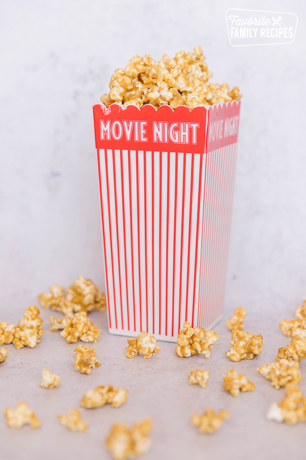 Peanut butter popcorn in a red and white striped movie night popcorn box