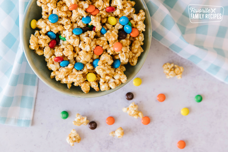 Peanut Butter Popcorn with M&M's in a white bowl