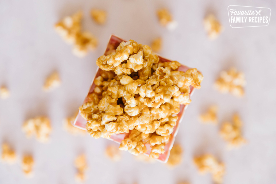 Peanut Butter Popcorn popping out of a popcorn container