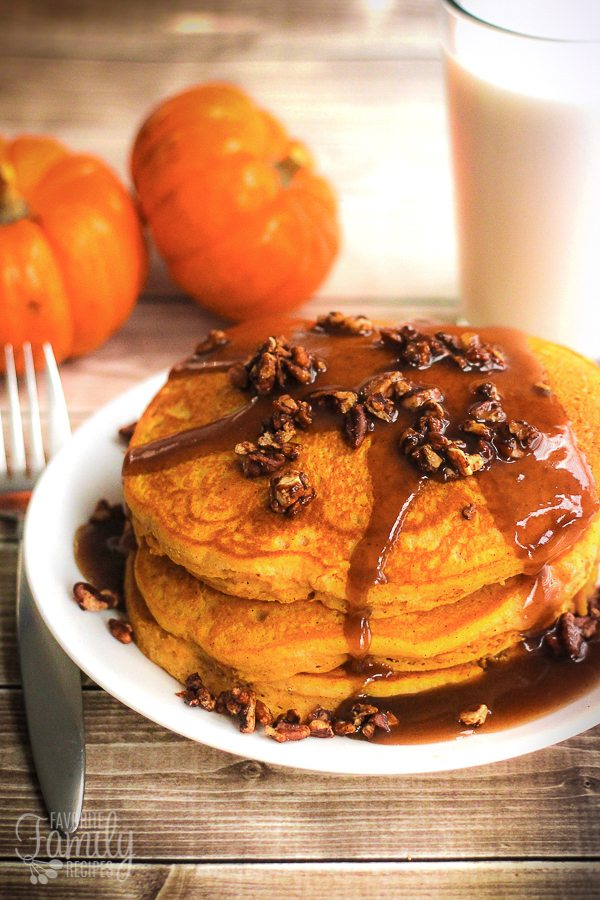 Pumpkin Pancakes with Caramel Maple Syrup and Candied Pecans is like eating dessert for breakfast. Our favorite pancake recipe in the fall season!