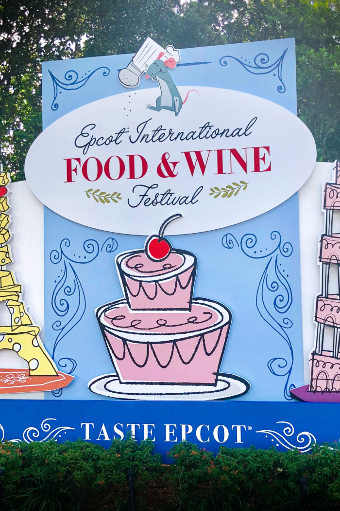 Epcot International Food and Wine Festival Sign with Remy from Ratatouille sprinkling salt on the sign
