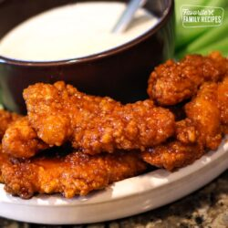 Wingers Sticky Fingers with Freakin Amazing Sauce and ranch for dipping on a serving dish