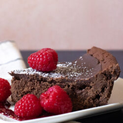 Side View of Flourless Chocolate Cake topped with powdered sugar