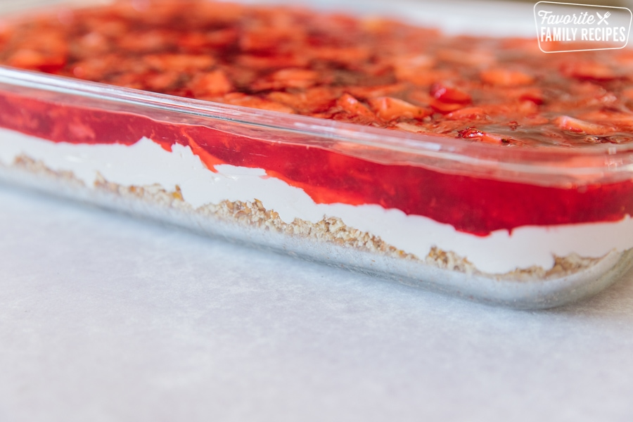 Side view of strawberry pretzel salad showing layers of pretzels, cream cheese filling, and strawberry jello
