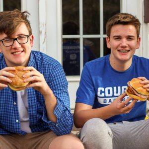 Teenagers eating Big Kahuna Teriyaki Sandwiches