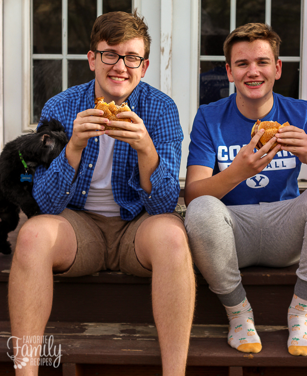 Two boys enjoying a Big Kahuna Teriyaki Chicken Sandwich