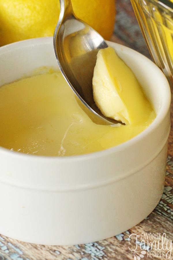 Lemon Custard being scooped from a ramekin with a spoon