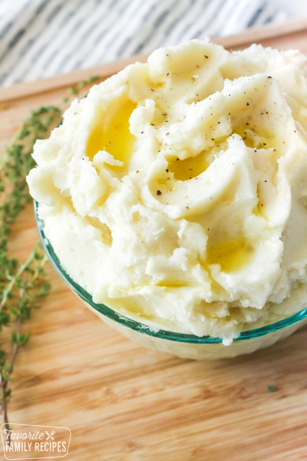 Mashed potatoes in a bowl with butter
