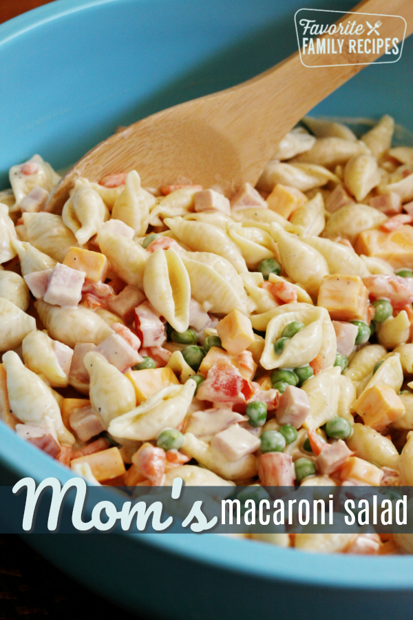 This is the perfect Traditional Macaroni Salad. It's loaded with ham, cheese, and veggies, in a creamy dressing. Perfect for BBQs and Potlucks! #macaronisalad #salad #macsalad #macaroni #pasta #pastasalad #cheese #ham #peas #noodles #carrots #creamydressing #potluckrecipe #bbqrecipe #bbqsalad #bbq #picnic #summersalad