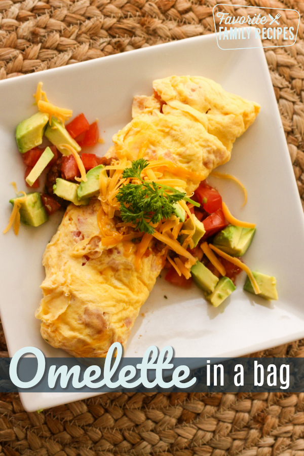 Omelette in a Bag is ideal for camping, family reunions, or at home wanting to switch things up.  The best part is the easy clean-up! #easyomelette #omeletteinabag #omelette #omelet #breakfastomelette #breakfastomelet #easybreakfast #campingrecipe #campingbreakfast #recipe #breakfastrecipe #eggrecipe #eggs #eggomelet #omeletrecipe #omeletterecipe
