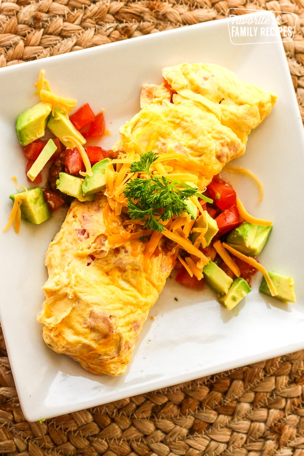Omelette in a Bag with tomatoes, avocado, and cheese toppings