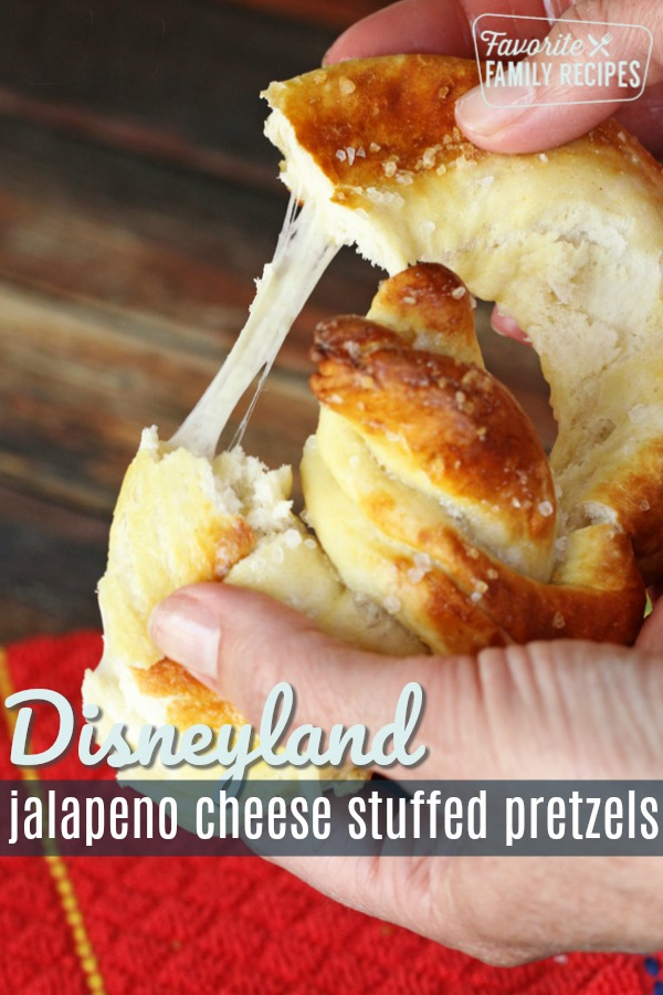 The jalapeño cheese stuffed pretzel is one of my very favorite treats at Disneyland. Now you can have this cheese-filled taste of Disney at home! #softpretzel #softpretzels #cheesetuffedpretzel #cheesepretzel #disneypretzel #disneyfood #disneycopycat #copycatrecipe #cheesefilledpretzel #cheese #pretzel #disney #disneyland #disneylandfood #pretzelrecipe #jalapenocheese #dough #bread #snack #disneysnack #cheesy #diy #recipe #favoriterecipe #favoritefamilyrecipes