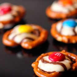 5 Pretzels with Hershey's hugs melted on top with an M&M in the middle
