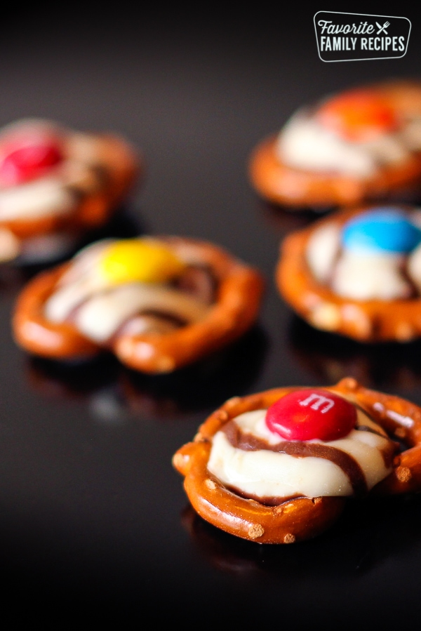 Belly Buttons - Pretzels with an m&m on top of a melted chocolate kiss