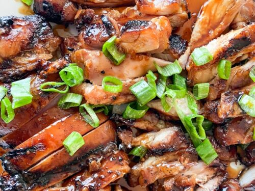 sliced grilled chicken teriyaki on a plate