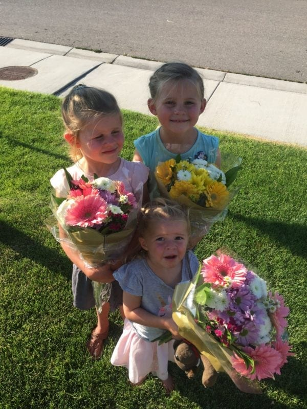 Young girls holding flower arrangements from the Albertsons grand opening in Boise