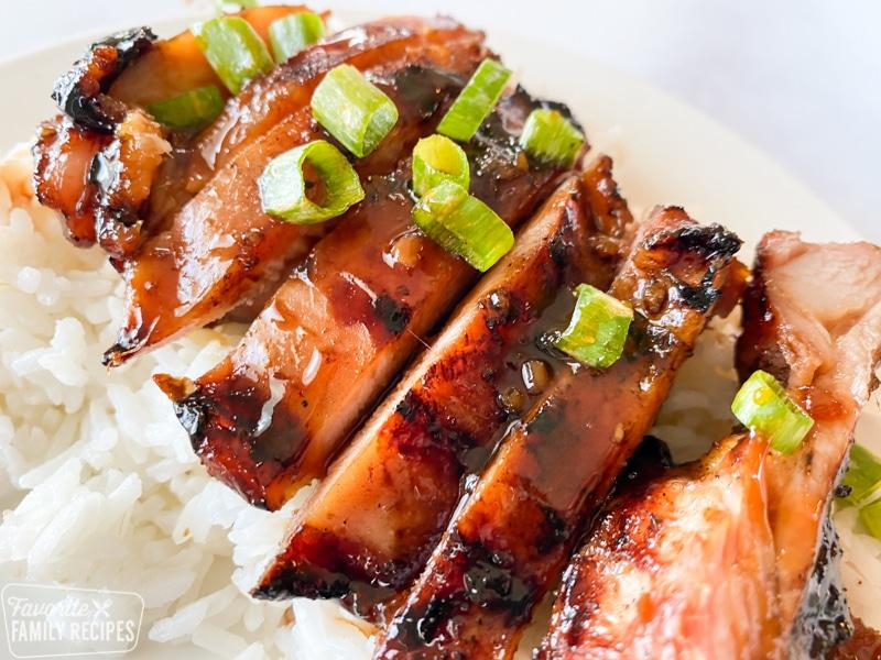 sliced teriyaki chicken over rice