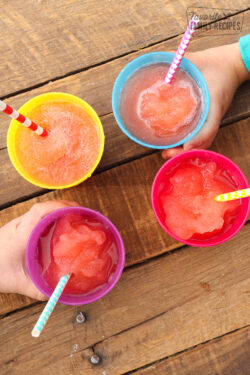 4 DIY magic slushies in rainbow colored cups with straws.