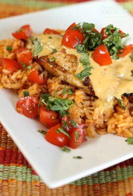 Mexican chicken served on a bed of rice topped with chopped tomatoes and cilantro