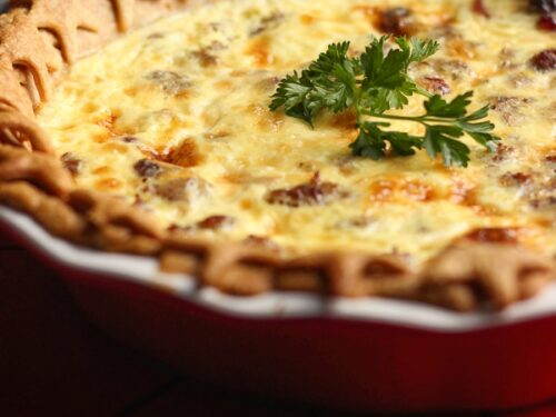 Christmas quiche in a pie pan topped with a garnish