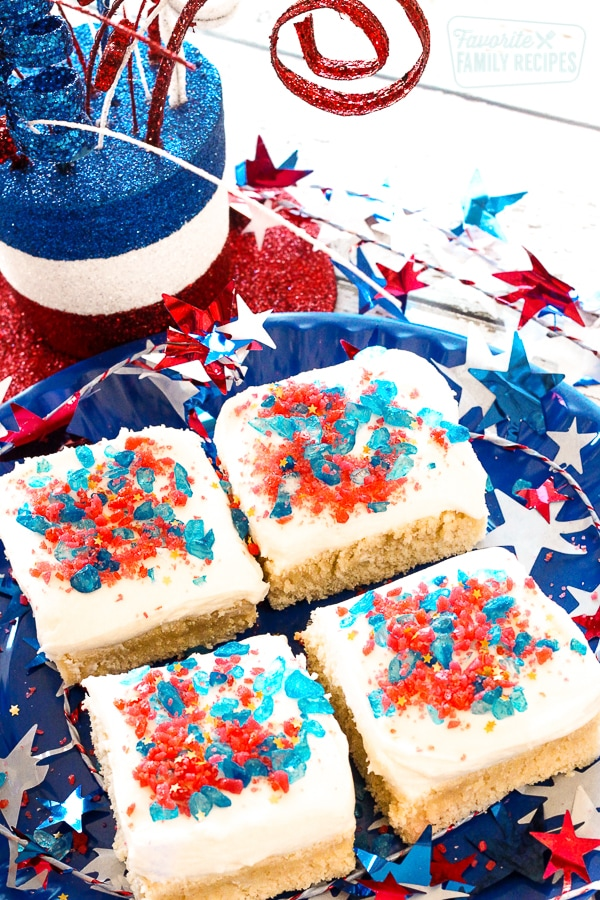 4 Firecracker Sugar Cookie Bars on a plate surrounded by fourth of july decorations.