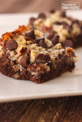 A German Chocolate Cookie Bar with another one in the background on a plate.