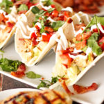 Grilled Chicken BLT Tacos on a white plate.